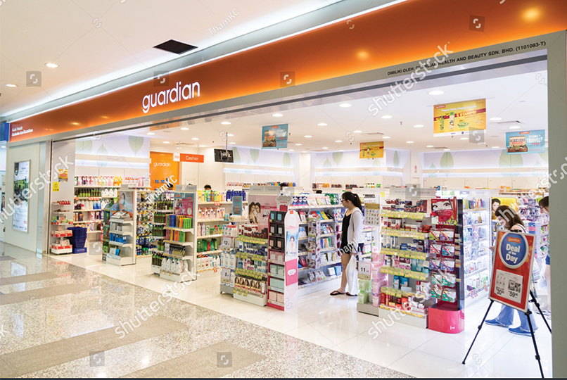 The entrance to a well-lit pharmacy