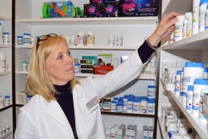 Pharmacist reaching for a prescription