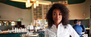 headshot of a women in a restaurant