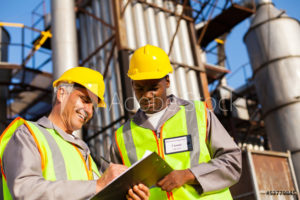 Two construction men reading a binder