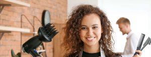 Head shot of a women hair dresser with a blow dryer