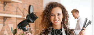 Women hairdresser holding hair dryer